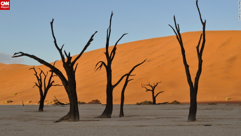 """Completely otherworldly"" is how <a href=""http://ireport.cnn.com/docs/DOC-1138980"">Estin Yang</a> describes his visit to Sossusvlei in Namibia's<a href=""http://www.namibiatourism.com.na/pages/national+parks"" target=""_blank""> Namib-Naukluft National Park</a>. He and his wife camped out at the gates two hours before sunrise to make sure they could reach the sand dunes in the perfect light."