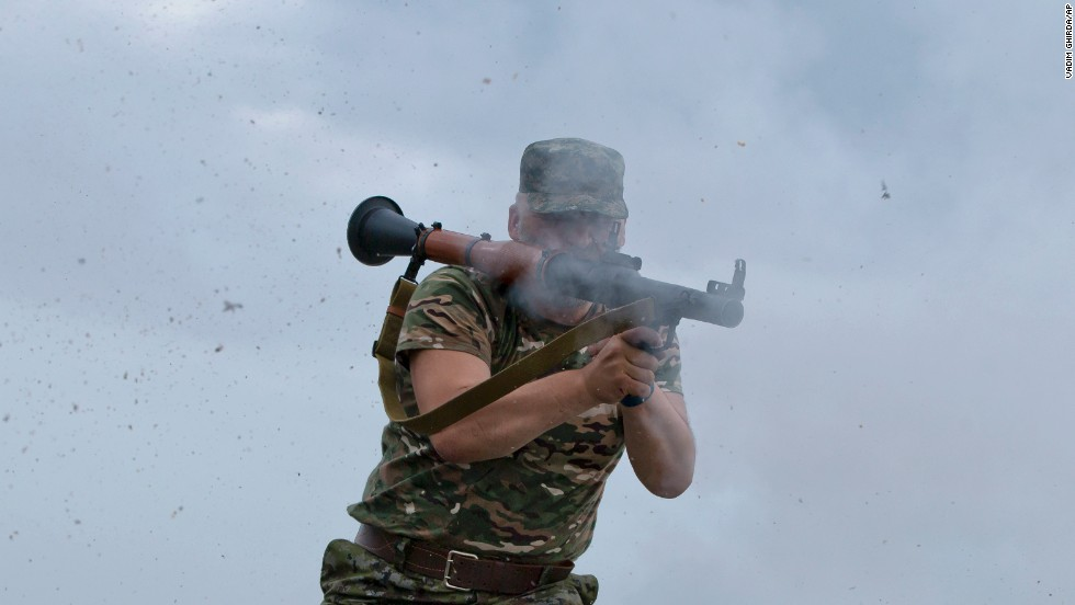"A pro-Russian rebel fires a rocket-propelled grenade on the rooftop of an apartment building during clashes with Ukrainian troops Monday, June 2, on the outskirts of Luhansk, Ukraine. The fighting is <a href=""http://www.cnn.com/2014/05/27/world/gallery/ukraine-after-election/index.html"">intensifying in eastern Ukraine</a>, where a large separatist movement has arisen following Russia's takeover of the Crimean peninsula."