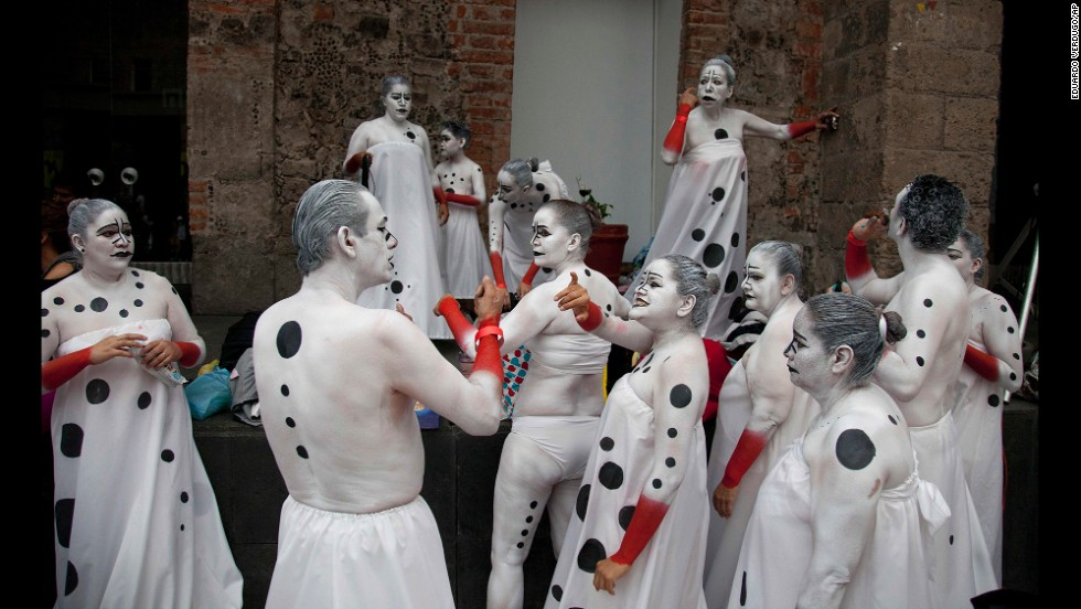 People decorated in body paint use sign language to communicate with each other Friday, May 30, during the International Fonambules Body Paint Festival in Mexico City. This year, the festival focused on language motifs.