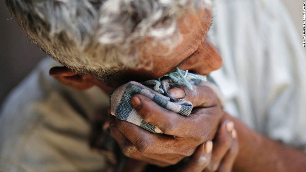 "The father of one of the two teenage girls <a href=""http://www.cnn.com/2014/06/01/world/asia/india-gang-rape/index.html"">who were raped and hanged</a> in India's Katra village weeps at his home Saturday, May 31. At least five people have been arrested."