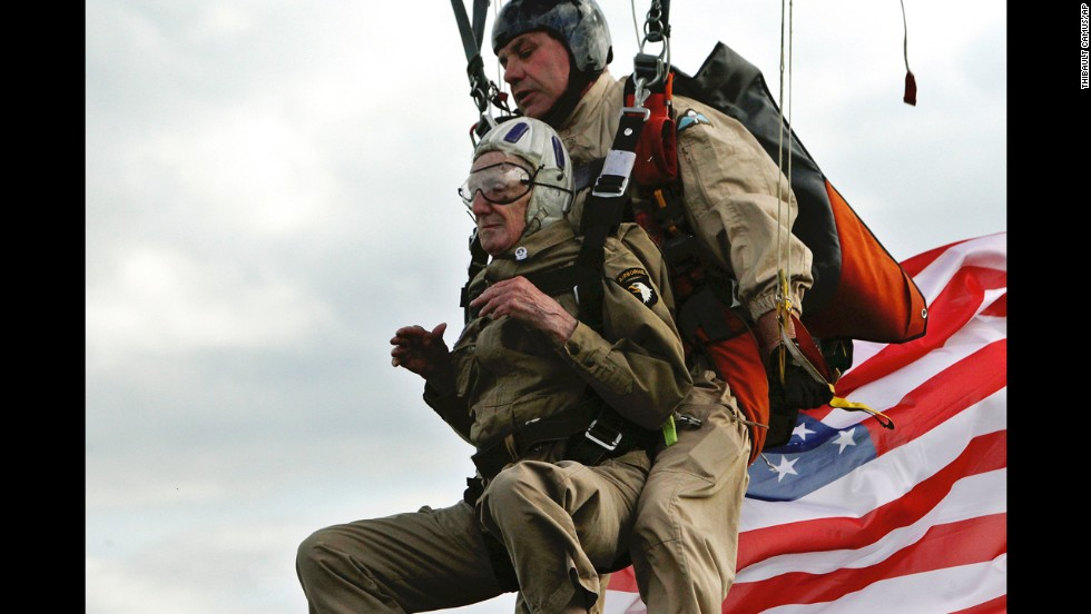 "World War II veteran Jim Martin, 93, completes a tandem parachute jump on a beach in western France on Thursday, June 5, a day before the 70th anniversary of D-Day. D-Day was <a href=""http://www.cnn.com/2012/06/05/world/gallery/d-day/index.html"">the largest seaborne invasion</a> in history. More than 150,000 Allied troops -- about half of them Americans -- invaded Western Europe, overwhelming German forces in an operation that proved to be a turning point in World War II."