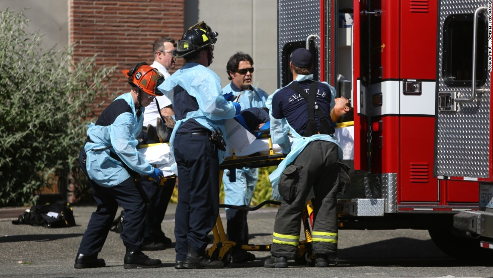 Seattle firefighters load a victim into an ambulance near the scene of the shooting.