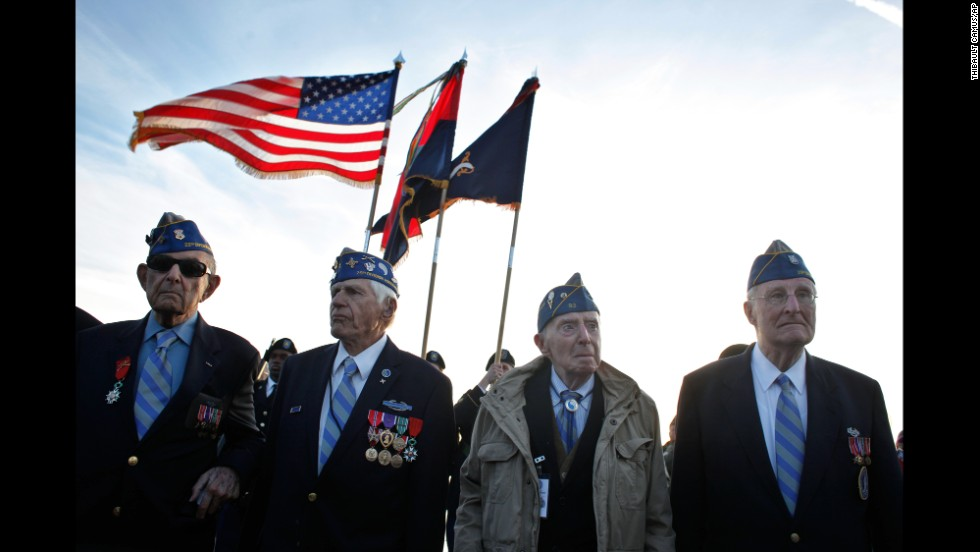 World War II veterans from the U.S. 29th Infantry Division, from left, Hal Baumgarter, Steve Melnikoff, Don McCarthy and Morley Piper attend a D-Day commemoration on Omaha Beach.