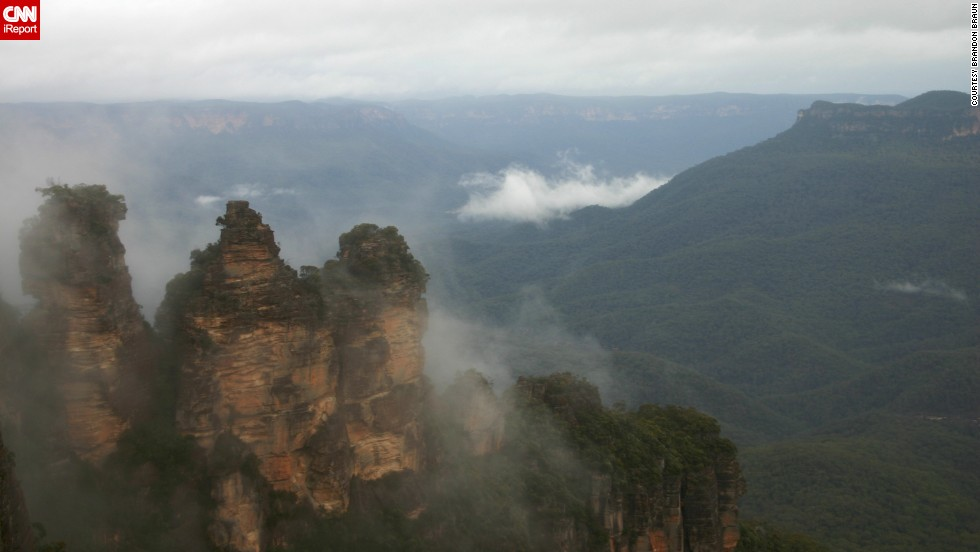 "Australia's <a href=""http://www.environment.nsw.gov.au/NationalParks/parkHome.aspx?id=N0004"" target=""_blank"">Blue Mountains National Park</a> is home to the Three Sisters sandstone peaks, towering amid the cliffs of the Jamison Valley. Take a walk from there into the rain forest, where you're surrounded by waterfalls, says <a href=""http://ireport.cnn.com/docs/DOC-1141272"">Brandon Braun</a>, who visited in 2008. ""The quiet and peacefulness of the area is enchanting."""
