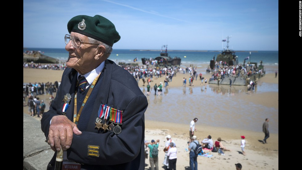 British veteran John Trevor sits by the beach in Arromanches-les-Bains on June 6.