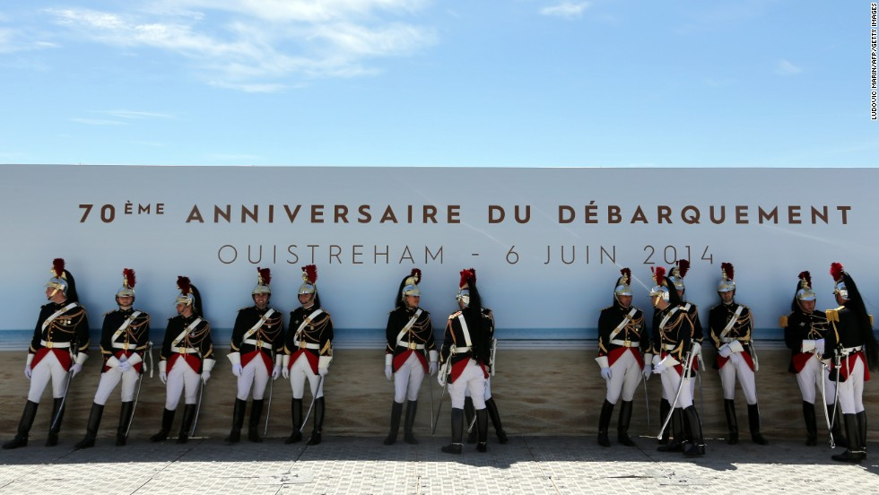 French Republican Guards stay in the shade before a ceremony in Ouistreham.