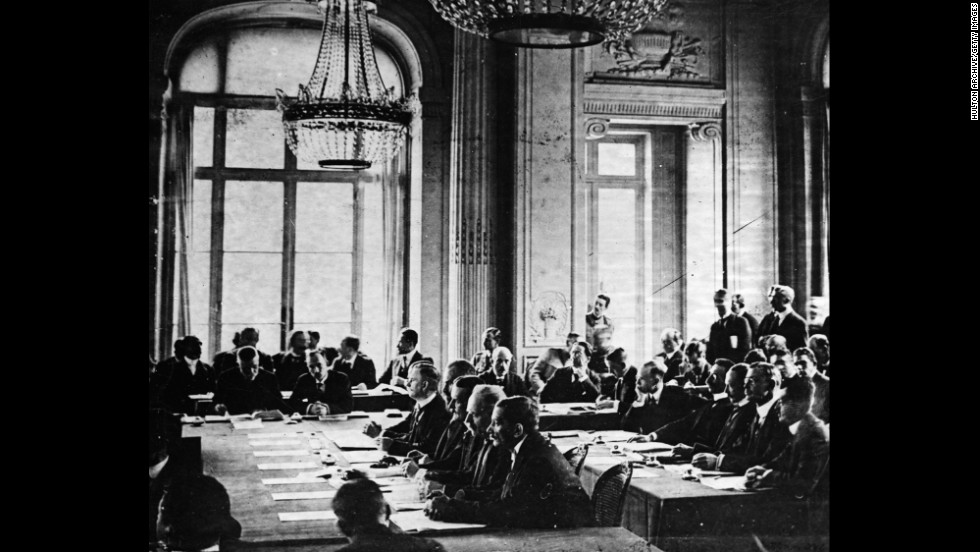 German delegates listen to French Prime Minister Georges Clemenceau's speech during the signing of the Treaty of Versailles in France on June 28, 1919.