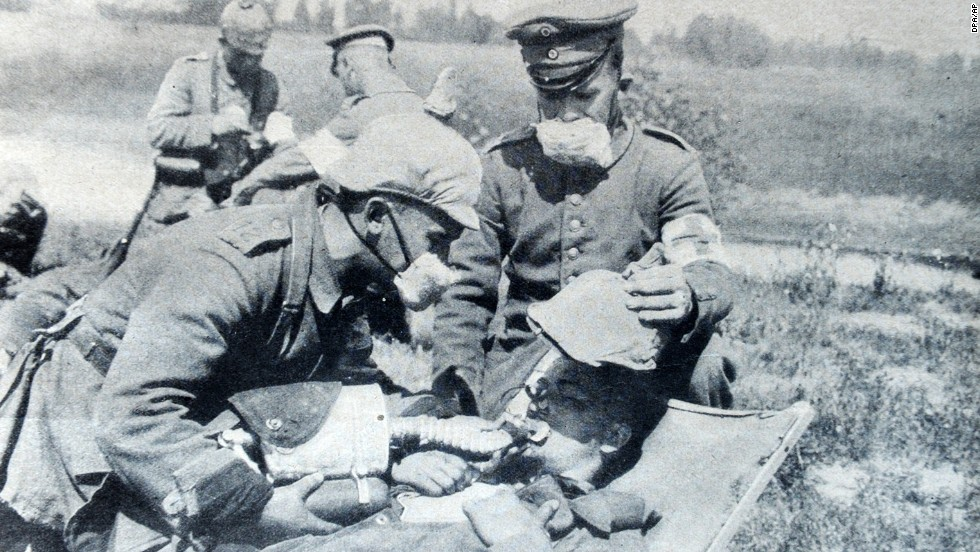 Germans give oxygen to a gas victim in 1915. The cloth masks worn by these soldiers provided little defense; more substantial gas masks were not produced until 1916. By the end of the war, even horses and dogs used at the front had their own gas masks.