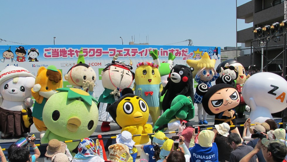 "Japan's most popular mascots pose together on stage. Each mascot represents a city or prefecture and their appearance is linked to their place of origin. Funassyi gets his namesake and looks from ""nashi"" or pear, a product his city of Funabashi is famous for."