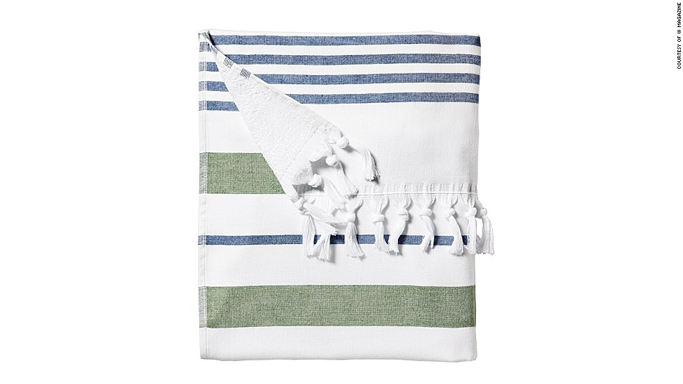 "This Turkish-inspired towel doubles as a sarong out. Serena & Lily Fouta Beach Towel, <a href=""serenaandlily.com"" target=""_blank"">serenaandlily.com</a>."