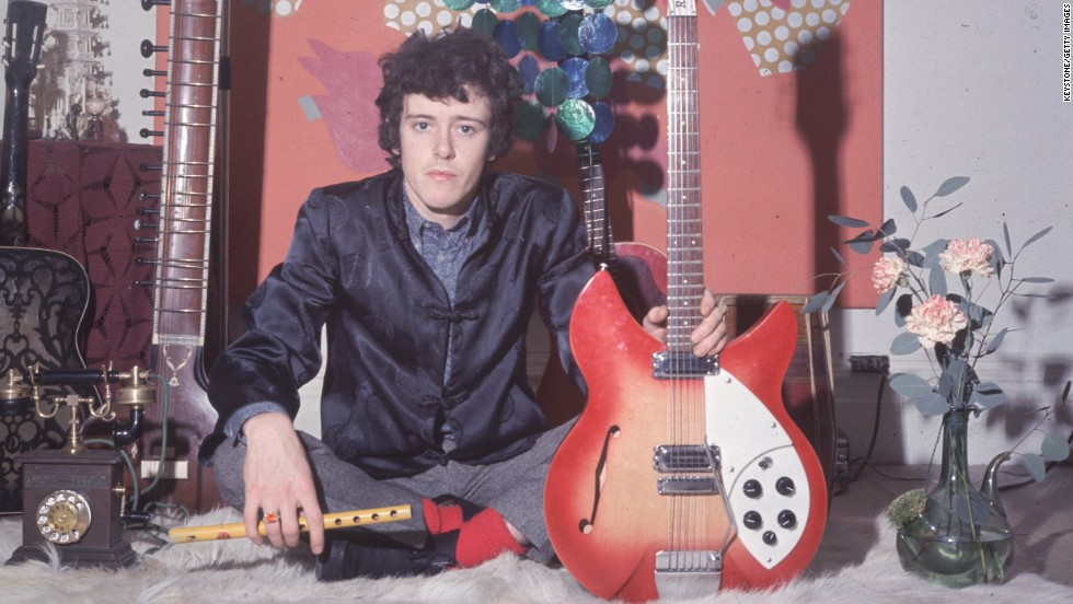"""Donovan holds his Rickenbacker guitar. He sang a mixture of folk and blues with wistful lyrics that captured the mood of the love generation. He recorded """"Catch the Wind"""" when he was just 18."""