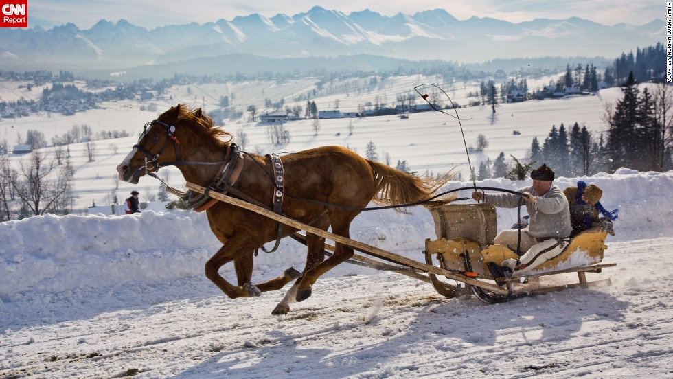 "A sleigh rider is carried through the Malopolska region of <a href=""http://www.poland.travel/en/nature/tatra-national-park"" target=""_blank"">Tatra National Park</a> in Poland. <a href=""http://ireport.cnn.com/docs/DOC-1138891"">Adrian Lukas Smith took</a> this photo and works closely with the park. He says his favorite part of this region is the landscape and the Tatra Mountains, which are a natural border between Poland and Slovakia."