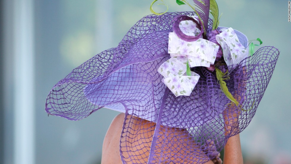 Feathers adorn the hat of a racing fan, dressed for the occasion at Belmont Park.