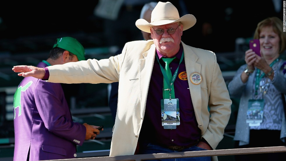 Steve Coburn, co-owner of California Chrome, waves to fans before the race.