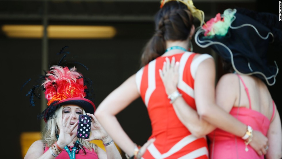 Kylie Fouchee, left, takes a photo of Vicki Dimitri, center, and her mother Linda Fouchee while enjoying the scene at Belmont Park.