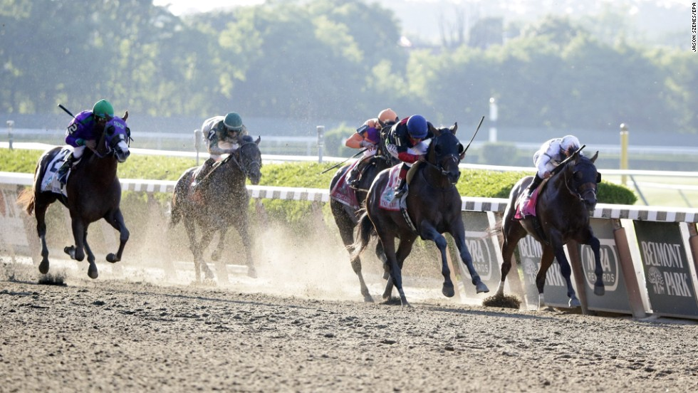 Tonalist crosses the finish line to win the Belmont Stakes on June 7 in Elmont, New York. California Chrome, far left, was bidding to become the first Triple Crown winner since 1978, but instead finished in a dead heat for fourth.