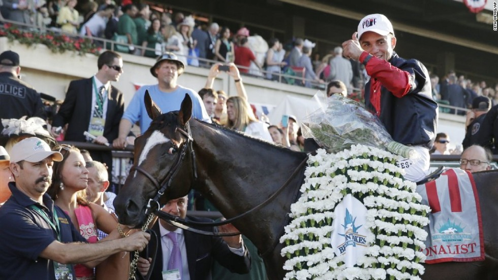 Joel Rosario poses for photos atop Tonalist after winning the 146th running of the Belmont Stakes horse race, Saturday, June 7, 2014, in Elmont, New York.