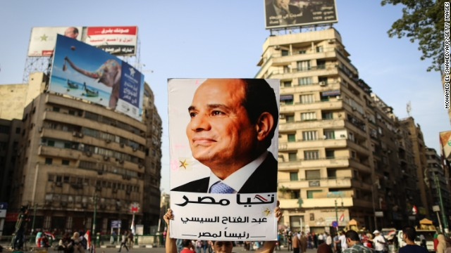 An Egyptian man holds up a portrait of ex-army chief Abdel Fattah al-Sisi as he celebrates in Cairo's Tahrir Square on June 3, 2014 after Sisi won 96.9 percent of votes in the country's presidential election.