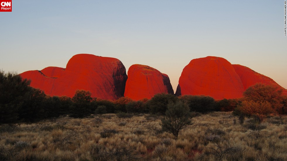 "<a href=""http://www.parksaustralia.gov.au/uluru/people-place/amazing-facts.html"" target=""_blank"">Uluru-Kata Tjuta National Park</a> in Australia is home to one of the largest sandstone monoliths in the world. <a href=""http://ireport.cnn.com/docs/DOC-1141663"">Anusha Mookherjee</a> says the park feels incredibly spiritual. From her experience, the best time to visit is at sunrise or sunset. ""It is extremely stunning at sunset when the rocks glow a deep, fiery red,"" she said."