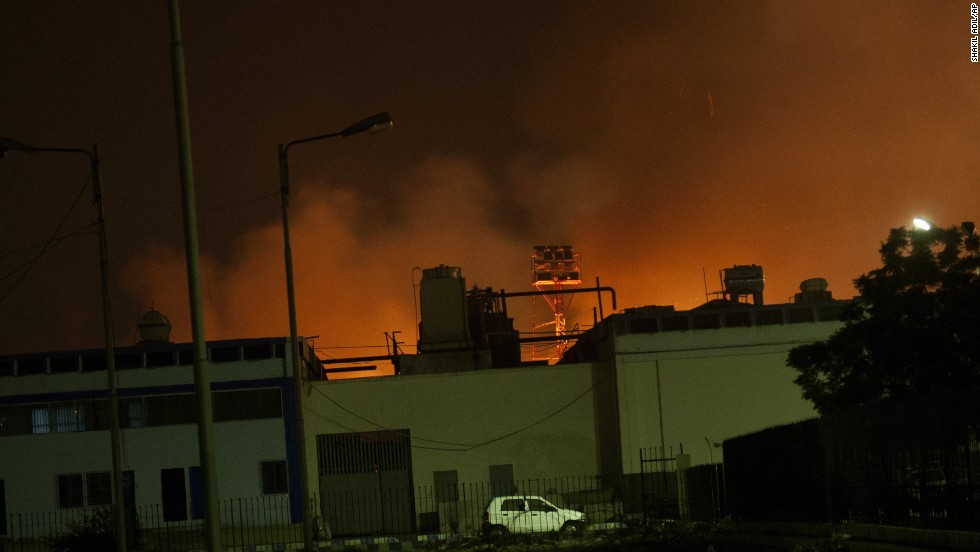 Fire illuminates the sky above a terminal at the  airport, Pakistan's largest and busiest, on June 8.