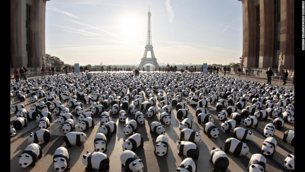 The papier-mâché pandas gather en masse near the Eiffel Tower in Paris in October 2008.