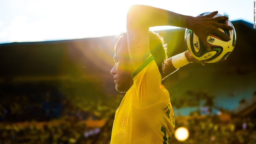 "Brazilian soccer star Neymar executes a throw-in during an international friendly match against Panama on Tuesday, June 3, in Goiania, Brazil. Neymar is one of the leading goal scorers for the Brazilian national team, which many consider the favorite going into the World Cup. <a href=""http://www.cnn.com/2014/06/06/worldsport/gallery/32-players-world-cup/index.html"">See 32 players to watch during the World Cup</a>"