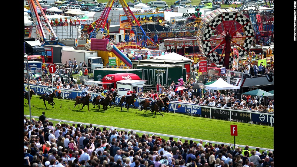 Horses compete in front of a large crowd Saturday, June 7, at the Epsom Downs Racecourse near Epsom, England.