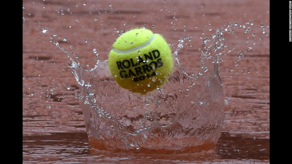 During a rain delay at the French Open, a tennis ball rebounds off the tarp covering the Philippe Chatrier court Wednesday, June 4, at the Roland Garros tennis complex in Paris.