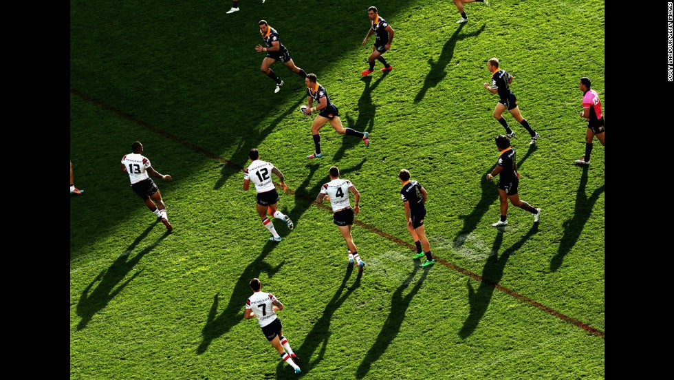 Ryan Hoffman of the Melbourne Storm runs with the ball during a National Rugby League match against the Sydney Roosters on Sunday, June 8, in Melbourne. The Roosters won 32-12.