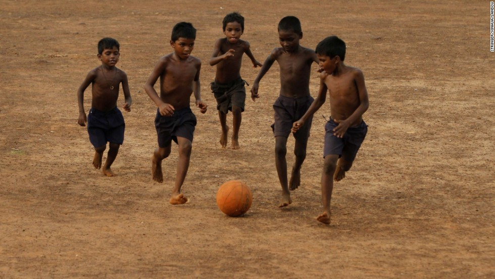 Children play soccer on a playground in Bhubaneswar, India, on Sunday, June 8.