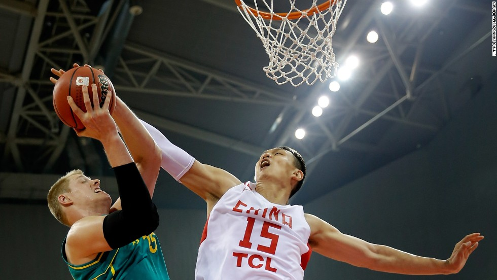 Luke Nevill of Australia, left, drives to the basket against Xu Zhonghao of China during a game between the two countries' national teams Friday, June 6, in Zhenjiang, China. The two teams just completed a four-game series, with each team winning twice.