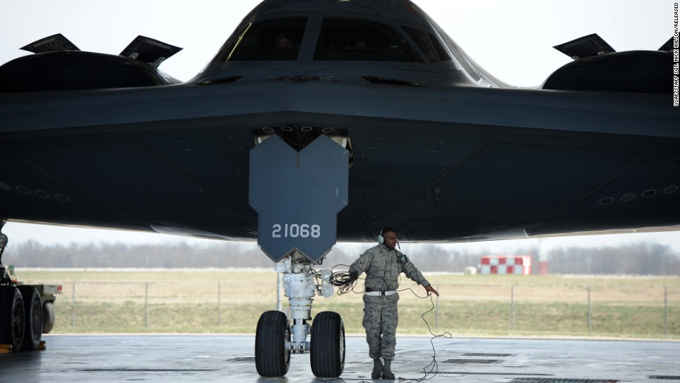Airman 1st Class Steven McCray, a B-2 crew chief, performs pre-flight checks at Whiteman in April 2013. Each B-2 costs about $1.16 billion.