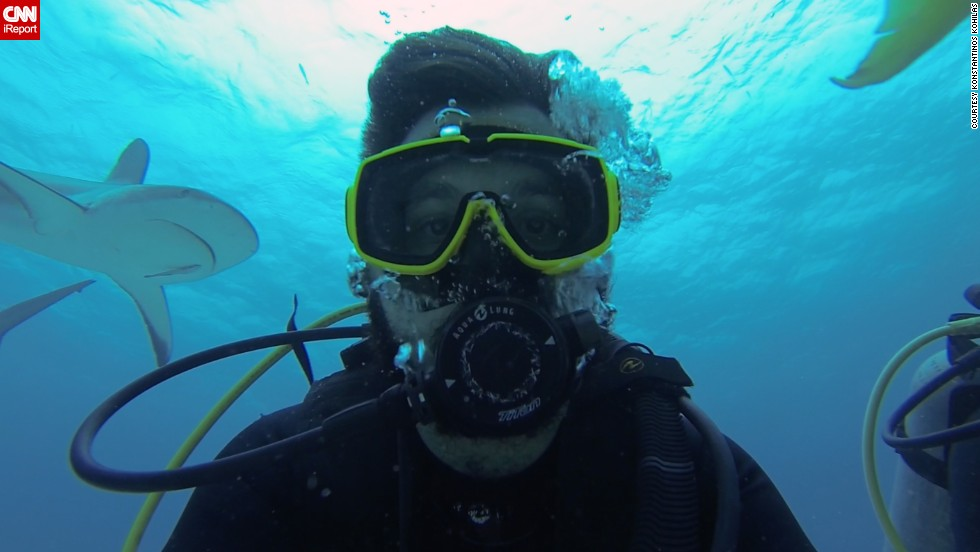 "During a dive at Stuart Cove in Nassau, Bahamas, <a href=""http://ireport.cnn.com/docs/DOC-1065740"">Konstantinos Kohilas</a> gets photo bombed during an underwater selfie by a shark."