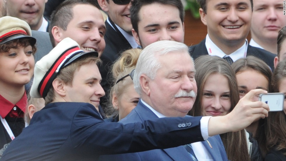 "Former Polish President Lech Walesa has his photo taken with well-wishers in Warsaw, Poland, on Wednesday, June 4. Walesa was attending a ceremony that marked the 25th anniversary of Poland's return to democracy. U.S. President Barack Obama also attended the ceremony during his <a href=""http://www.cnn.com/2014/06/03/politics/gallery/obama-europe-june/index.html"">recent trip to Europe</a>."