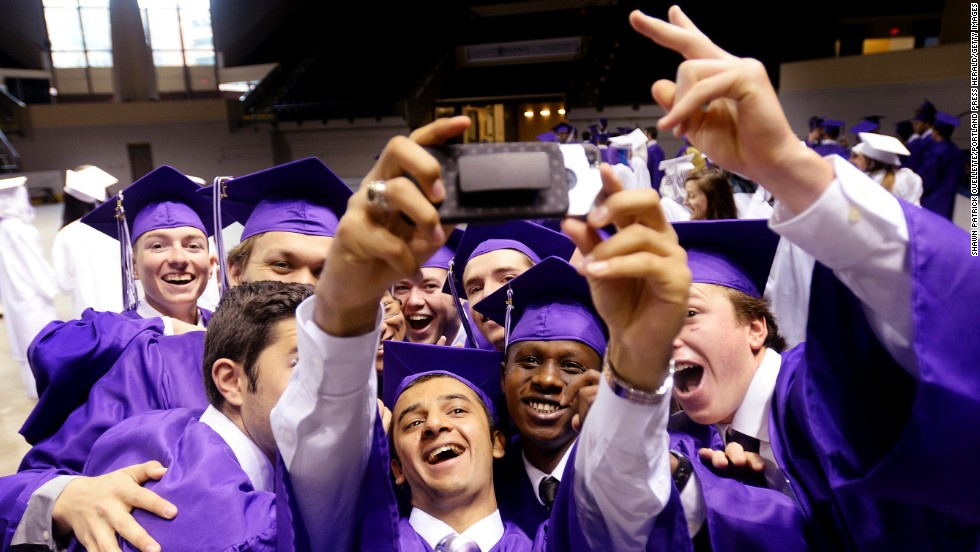 Classmates from Deering High School take a photo together prior to graduation Thursday, June 5, in Portland, Maine.