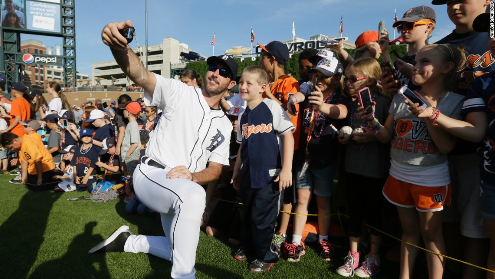 Detroit Tigers pitcher Justin Verlander takes a selfie with a group of children Sunday, June 8, before a home baseball game against the Boston Red Sox.