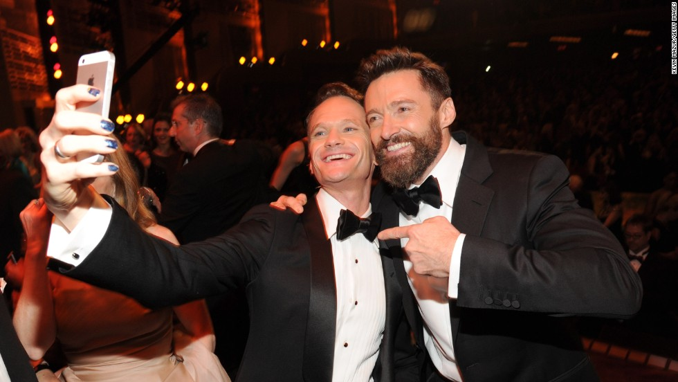 Actors Neil Patrick Harris, left, and Hugh Jackman attend the Tony Awards at New York's Radio City Music Hall on Sunday, June 8. It was Jackman's fourth time hosting the awards show, which honors the best on Broadway. Harris has also hosted the show four times.
