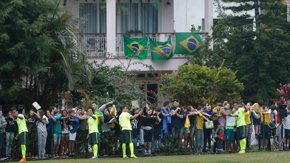 Members of the Brazilian national soccer team take selfies and sign autographs for fans after a training session Monday, June 9, in Teresopolis, Brazil.