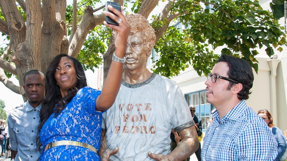 "Actors Shondrella Avery and Efren Ramirez, who both appeared in ""Napoleon Dynamite,"" stand next to a statue of the film's main character Monday, June 9, in Century City, California. Fox Searchlight Pictures and 20th Century Fox Home Entertainment were celebrating the movie's 10th anniversary."
