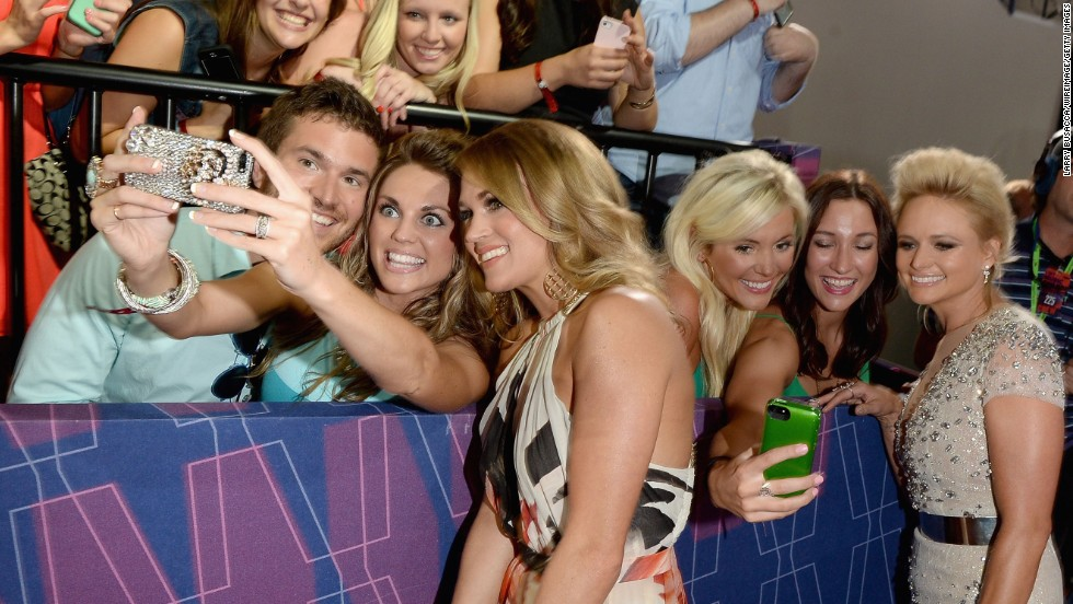 Country music stars Miranda Lambert, right, and Carrie Underwood take photos with fans Wednesday, June 4, at the CMT Music Awards in Nashville, Tennessee.
