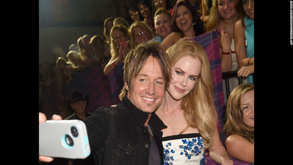 Country music singer Keith Urban and his wife, actress Nicole Kidman, arrive at the CMT Music Awards.