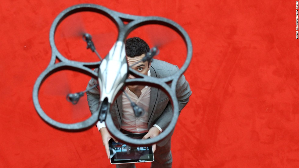 A man controls an Parrot AR Drone with an iPad during the press preview day of the International Toy Fair in Nuernberg, Germany, on February 2, 2011.