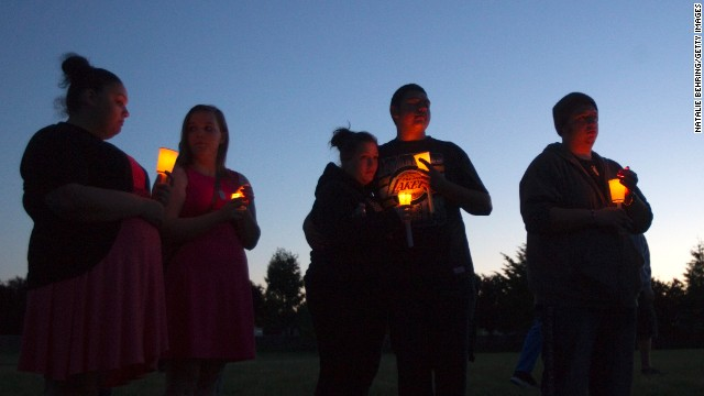 TROUTDALE, OR - JUNE 10:   Friends, family and well-wishers hold candles for Emilio Hoffman, the victim of today's school shooting at a vigil on  June 10, 2014 in Troutdale, Oregon. A gunman walked into Reynolds High School  with a rifle and shot 14 year old Hoffman to death on Tuesday, in what is the the third outbreak of gun violence in a U.S. school in less than three weeks. (Photo by Natalie Behring/Getty Images)