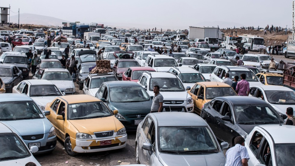 'Vehicles clog a highway as refugees flee Mosul on Tuesday, June 10.' from the web at 'http://i2.cdn.turner.com/cnnnext/dam/assets/140611080700-01-iraqi-civilians-flee-mosul-restricted-horizontal-large-gallery.jpg'