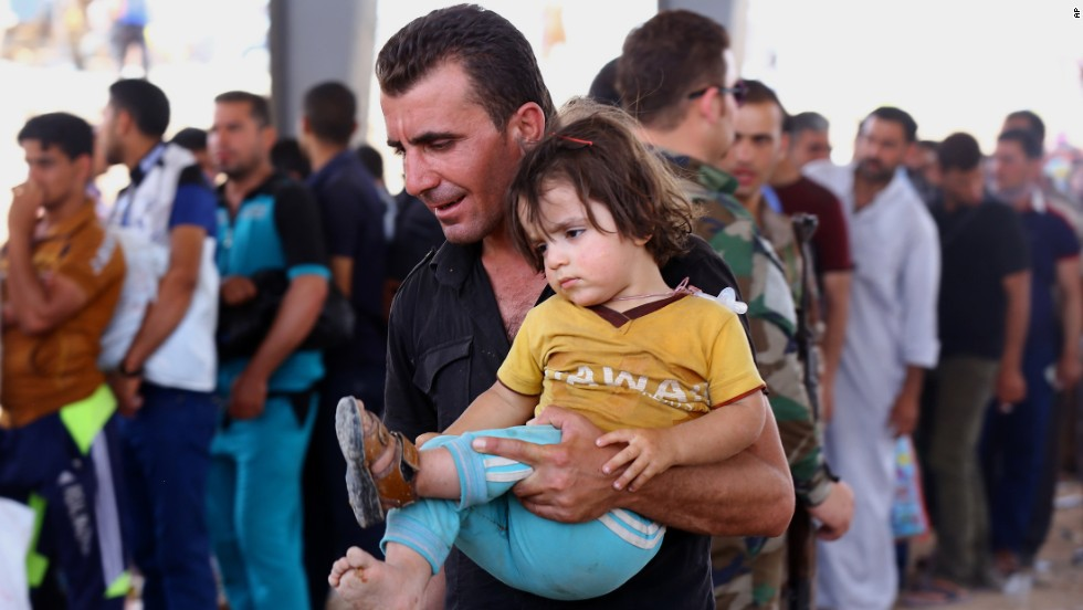 Refugees are seen in Erbil on June 10.