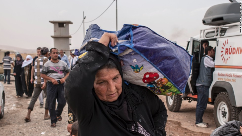 'The rush from Mosul led to bottlenecks at checkpoints as people tried to reach safety in Erbil, about 90 kilometers (56 miles) to the east.' from the web at 'http://i2.cdn.turner.com/cnnnext/dam/assets/140611080723-05-iraqi-civilians-flee-mosul-restricted-horizontal-large-gallery.jpg'