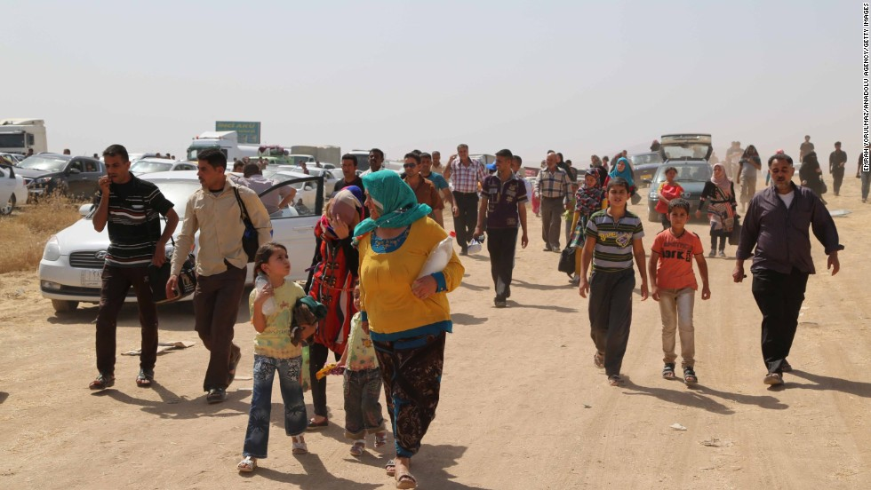 'Many people are fleeing on foot. Mosul's four main hospitals are inaccessible because of fighting, and some mosques have been converted to act as clinics, the International Organization for Migration said.' from the web at 'http://i2.cdn.turner.com/cnnnext/dam/assets/140611080728-06-iraqi-civilians-flee-mosul-horizontal-large-gallery.jpg'