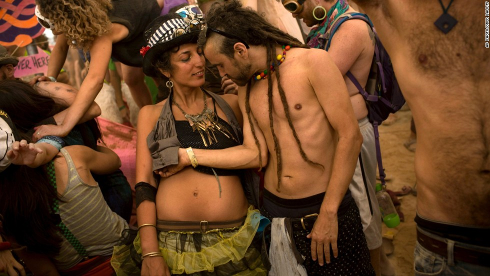 JUNE 11 - SDE BOKER, ISRAEL: People dance at a party during the country's first Midburn festival in the desert near the kibbutz of Sde Boker on June 10. The event is modeled on the popular Burning Man festival held annually in the Black Rock Desert of Nevada.