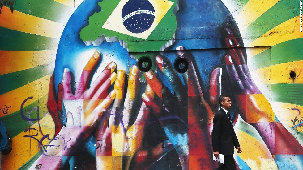 In this attention-grabbing image a collection of multi-colored hands support the planet marked with a Brazilian flag, welcoming visitors from across the world to South America's largest nation.