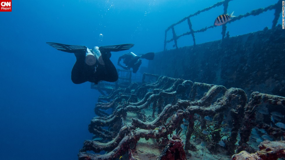 "Baki said, ""On my first dive trip, I had a small point and shoot camera, and this started me on my journey to learn underwater photography. I upgraded as I became more proficient."" Baki captured this image of divers exploring the wreck of the <a href=""http://ireport.cnn.com/docs/DOC-1142724"">USS Spiegel Grove</a> about 70 feet underwater in Key Largo, Florida."